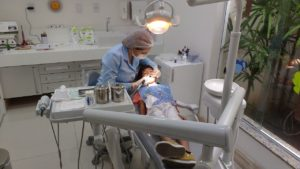 dentist with a dental implant patient
